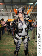 Купить «MOSCOW - OCT 12, 2014: The girl in a fantastic costume cosplayer at the EveryCon 2014 in the exhibition center Sokolniki», фото № 25841806, снято 12 октября 2014 г. (c) Losevsky Pavel / Фотобанк Лори