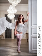 Купить «Young woman with her eyes close in white underwear, stockings and angel wings behind her back in room leaning her hand on door», фото № 25841878, снято 10 июня 2016 г. (c) Losevsky Pavel / Фотобанк Лори
