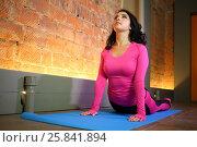 Купить «Beautiful woman in a pink tracksuit bends her back leaning hands on the floor», фото № 25841894, снято 10 июня 2015 г. (c) Losevsky Pavel / Фотобанк Лори