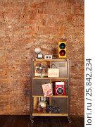 Купить «Retro studio with brick wall, shelves with radio, fan, helmet», фото № 25842234, снято 9 февраля 2016 г. (c) Losevsky Pavel / Фотобанк Лори