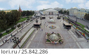 Купить «MOSCOW - AUG 12, 2014: Fountains on Manezh Square, aerial view. View of the Central Exhibition Hall», фото № 25842286, снято 12 августа 2014 г. (c) Losevsky Pavel / Фотобанк Лори