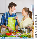 man and woman standing near table in domestic kitchen. Стоковое фото, фотограф Яков Филимонов / Фотобанк Лори