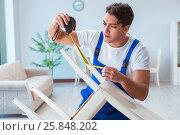 Купить «Repairman repairing broken chair at home», фото № 25848202, снято 28 ноября 2016 г. (c) Elnur / Фотобанк Лори