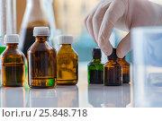 Купить «Various chemical solutions in the lab», фото № 25848718, снято 28 ноября 2016 г. (c) Elnur / Фотобанк Лори