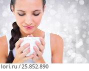 Купить «Close up of woman looking down at white cup against white bokeh», фото № 25852890, снято 12 июля 2020 г. (c) Wavebreak Media / Фотобанк Лори