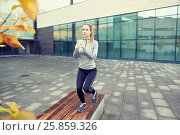 Купить «woman making step exercise on city street bench», фото № 25859326, снято 17 октября 2015 г. (c) Syda Productions / Фотобанк Лори