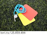 Купить «whistle and caution cards on football field», фото № 25859494, снято 18 сентября 2016 г. (c) Syda Productions / Фотобанк Лори