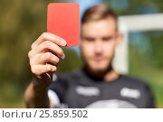 Купить «referee hands with red card on football field», фото № 25859502, снято 18 сентября 2016 г. (c) Syda Productions / Фотобанк Лори