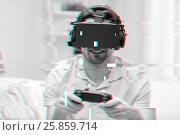 Купить «man in virtual reality headset with controller», фото № 25859714, снято 12 марта 2016 г. (c) Syda Productions / Фотобанк Лори