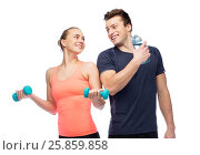 Купить «sportive man and woman with dumbbell and water», фото № 25859858, снято 2 марта 2017 г. (c) Syda Productions / Фотобанк Лори