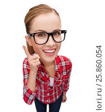 smiling teenager in eyeglasses with finger up. Стоковое фото, фотограф Syda Productions / Фотобанк Лори