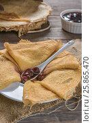 Pancakes with cherry jam. Стоковое фото, фотограф Nunik Varderesyan / Фотобанк Лори