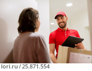 Купить «deliveryman with tablet pc and box at customer», фото № 25871554, снято 3 декабря 2016 г. (c) Syda Productions / Фотобанк Лори
