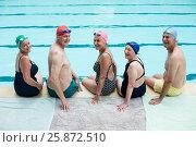 Купить «Cheerful senior swimmers sitting at poolside», фото № 25872510, снято 12 декабря 2016 г. (c) Wavebreak Media / Фотобанк Лори