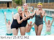 Купить «Senior female swimmers holding trophy at poolside», фото № 25872962, снято 12 декабря 2016 г. (c) Wavebreak Media / Фотобанк Лори