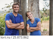 Купить «Smiling man and woman standing with arms crossed during obstacle course», фото № 25873862, снято 24 ноября 2016 г. (c) Wavebreak Media / Фотобанк Лори
