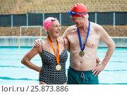 Купить «Cheerful senior couple standing at poolside», фото № 25873886, снято 12 декабря 2016 г. (c) Wavebreak Media / Фотобанк Лори