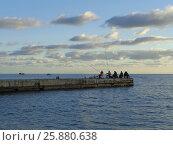 Купить «Морская рыбалка с пирса, вечерние облака», фото № 25880638, снято 15 октября 2016 г. (c) DiS / Фотобанк Лори
