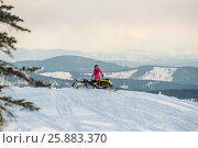 Rider on the snowmobile in the mountains. Стоковое фото, фотограф Алексей Суворов / Фотобанк Лори