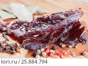 Pieces of beef jerky and spices. Стоковое фото, фотограф Ольга Соловьева / Фотобанк Лори