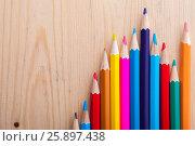 Купить «Group of multicolored bright pencils on table», фото № 25897438, снято 19 марта 2017 г. (c) Pavel Biryukov / Фотобанк Лори
