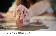 Male hand with pin on the map aiming destination. Стоковое видео, видеограф Швец Анастасия / Фотобанк Лори