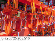 Купить «Wishing Wooden Torii at Fushimi Inari Taisha Shrine, the head shrine of Inari including trails up the mountain in Kyoto, Japan», фото № 25905510, снято 17 июля 2019 г. (c) BE&W Photo / Фотобанк Лори