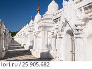 Купить «Kuthodaw Pagoda contains the worlds biggest book. There are 729 white stupas with caves with a marble slab inside - page with buddhist inscription. Mandalay, Myanmar», фото № 25905682, снято 16 февраля 2020 г. (c) BE&W Photo / Фотобанк Лори