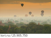 Купить «Hot air balloon over plain of Bagan in misty morning, Myanmar», фото № 25905750, снято 18 июня 2019 г. (c) BE&W Photo / Фотобанк Лори