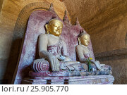 Купить «Bagan Twin ancient Buddha images in Dhammayangyi temple of Bagan, Mandalay, Myanmar», фото № 25905770, снято 23 сентября 2018 г. (c) BE&W Photo / Фотобанк Лори