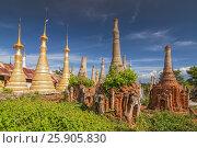 Купить «Buddhist stupas of Shwe Inn Thein Paya, pagoda complex, Inthein, Indein, Shan State, Myanmar», фото № 25905830, снято 17 февраля 2020 г. (c) BE&W Photo / Фотобанк Лори