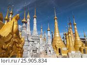 Купить «Golden stupas, Shwe Inn Thein Paya, Inthein, Inle Lake, Myanmar», фото № 25905834, снято 17 февраля 2020 г. (c) BE&W Photo / Фотобанк Лори