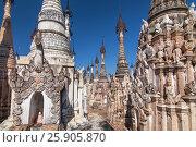 Купить «Kakku pagodas are nearly 2500 beautiful stone stupas hidden in a remote area of Myanmar near the lake Inle. This sacred place is on the territory of the PaO people. Shan state, Myanmar», фото № 25905870, снято 27 мая 2019 г. (c) BE&W Photo / Фотобанк Лори