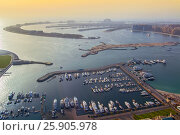 Купить «Jumeirah Palm Island Dubai shot from the rooftop top of the Princess tower in Dubai Marina, United Arab Emirates», фото № 25905978, снято 19 ноября 2018 г. (c) BE&W Photo / Фотобанк Лори