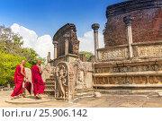 Купить «Monk walking in front of Vatadage (Round House) of Polonnaruwa ruin Unesco world heritage on Sri Lanka», фото № 25906142, снято 16 октября 2018 г. (c) BE&W Photo / Фотобанк Лори