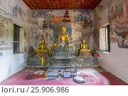 Купить «Seated Buddha statue with murals in the background, Wat Pak Huak, Luang Prabang, Laos, Indochina, Southeast Asia, Asia», фото № 25906986, снято 23 сентября 2018 г. (c) BE&W Photo / Фотобанк Лори