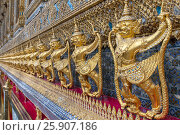 Купить «Garudas and nagas on external decorations of the Ubosoth, Wat Phra Kaew temple, Grand Palace, Bangkok, Thailand», фото № 25907186, снято 22 января 2019 г. (c) BE&W Photo / Фотобанк Лори