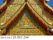 Купить «Decorative temple roof with shadow of adjacent chedi on the front in Chiang Mai Thailand», фото № 25907294, снято 21 августа 2019 г. (c) BE&W Photo / Фотобанк Лори