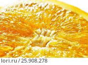 Slice of cut fresh ripe orange fruit, macro close up photo. Orange background. Стоковое фото, фотограф Irina Shisterova / Фотобанк Лори