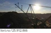 Купить «Mining boom. Excavator loads ore.Panorama. Artificial lake. Sunset. Development of minerals.», видеоролик № 25912866, снято 15 марта 2017 г. (c) Вячеслав Позднышев / Фотобанк Лори