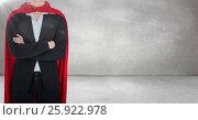 Купить «Business woman superhero with arms folded against grey wall with flare», фото № 25922978, снято 27 января 2020 г. (c) Wavebreak Media / Фотобанк Лори