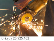 Man working with a power saw. Close-up . Стоковое фото, фотограф Владимир Семенчук / Фотобанк Лори