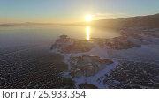 Купить «Аэросъемка с воздуха. Зима. Озеро Байкал», видеоролик № 25933354, снято 13 февраля 2017 г. (c) Виталий Зверев / Фотобанк Лори