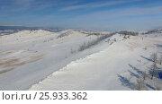 Купить «Аэросъемка с воздуха. Зима. Озеро Байкал», видеоролик № 25933362, снято 13 февраля 2017 г. (c) Виталий Зверев / Фотобанк Лори