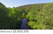 Купить «Аэровидеосъемка с воздуха. Летний лес с небольшой горной рекой», видеоролик № 25933370, снято 28 марта 2017 г. (c) Виталий Зверев / Фотобанк Лори