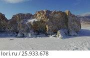 Купить «Аэросъемка с воздуха. Зима. Озеро Байкал», видеоролик № 25933678, снято 13 февраля 2017 г. (c) Виталий Зверев / Фотобанк Лори