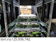 Купить «IT Engineer installs JBOD to rack in datacenter», фото № 25936742, снято 7 июля 2020 г. (c) Mikhail Starodubov / Фотобанк Лори