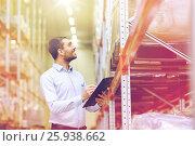 Купить «happy businessman with clipboard at warehouse», фото № 25938662, снято 9 декабря 2015 г. (c) Syda Productions / Фотобанк Лори
