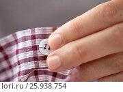 Купить «woman with needle stitching on button to shirt», фото № 25938754, снято 29 сентября 2016 г. (c) Syda Productions / Фотобанк Лори