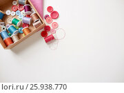 Купить «box with thread spools and sewing buttons on table», фото № 25938770, снято 29 сентября 2016 г. (c) Syda Productions / Фотобанк Лори